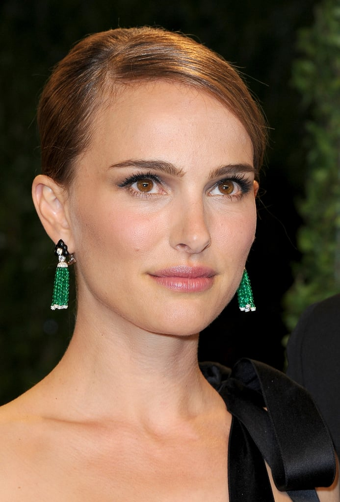 Natalie Portman sported emerald earrings at the Vanity Fair Oscars party.