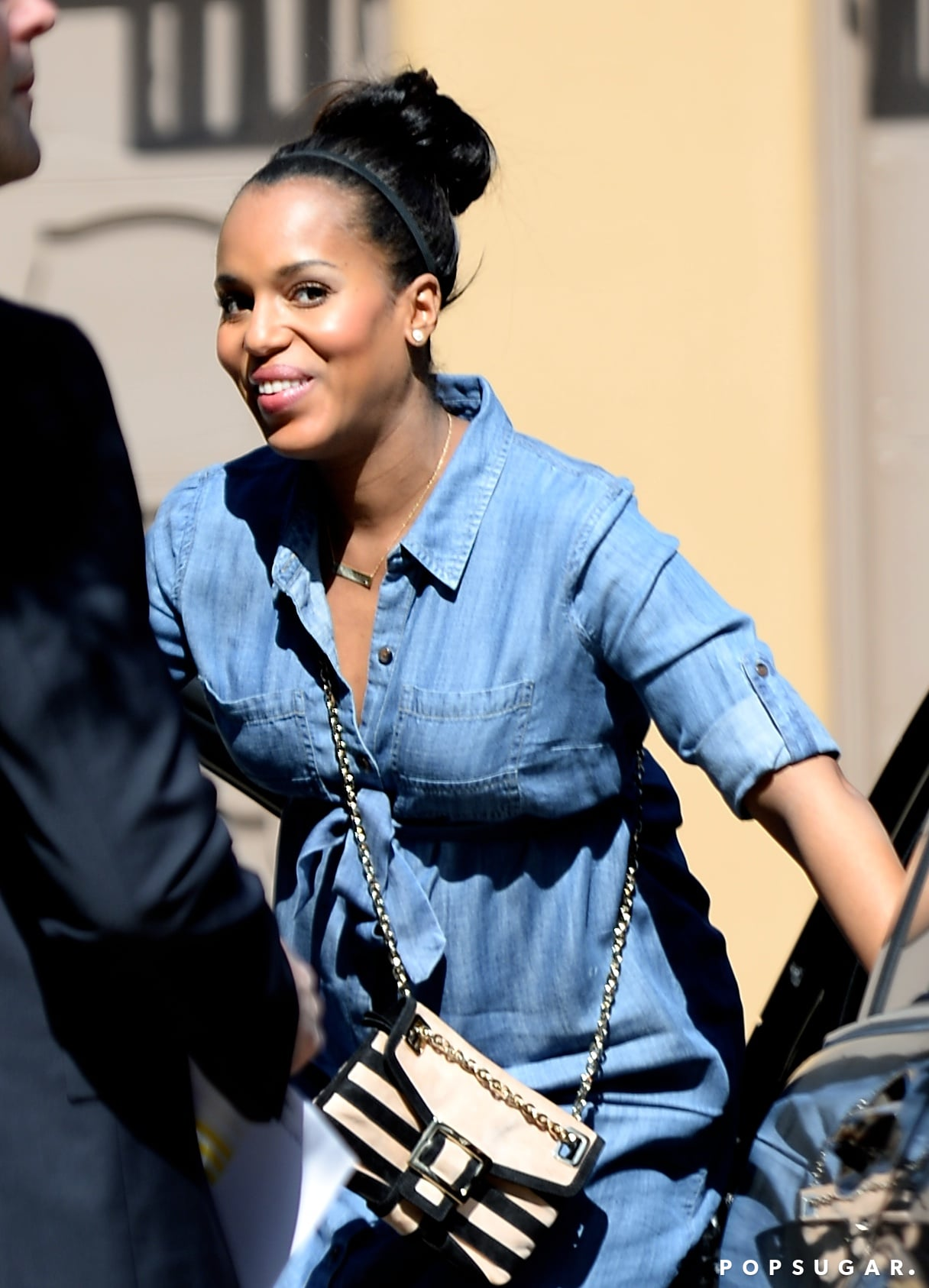 Kerry arrived in a chambray dress.