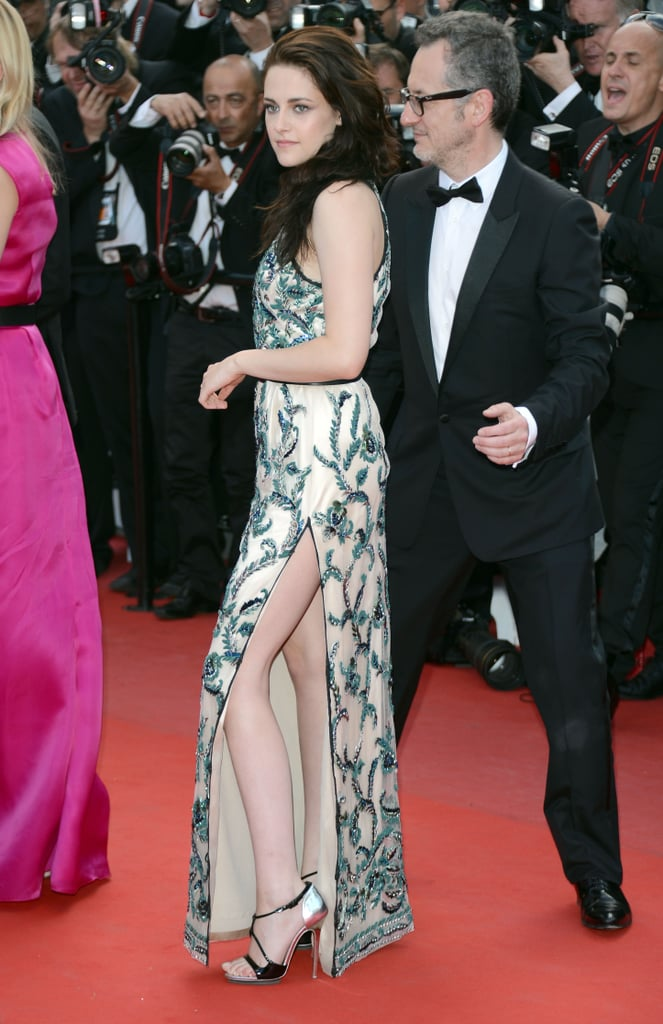 "Kristen Stewart, in a sexy Balenciaga gown with a slit, was back in front of the Cannes crowd for the premiere of On the Road in France today. She attended a photocall and press conference with costars Kirsten Dunst and Garrett Hedlund this morning. Kristen talked about her topless scenes in the film, saying, ""I love pushing. I love scaring myself."" This afternoon's event was extraspecial for Kristen, since she had boyfriend Robert Pattinson on hand for support. Rob's pal Tom Sturridge is also in the movie, and he posed alongside Kristen on his way into the screening."