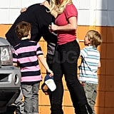 Britney kept an eye on the boys in the parking lot.