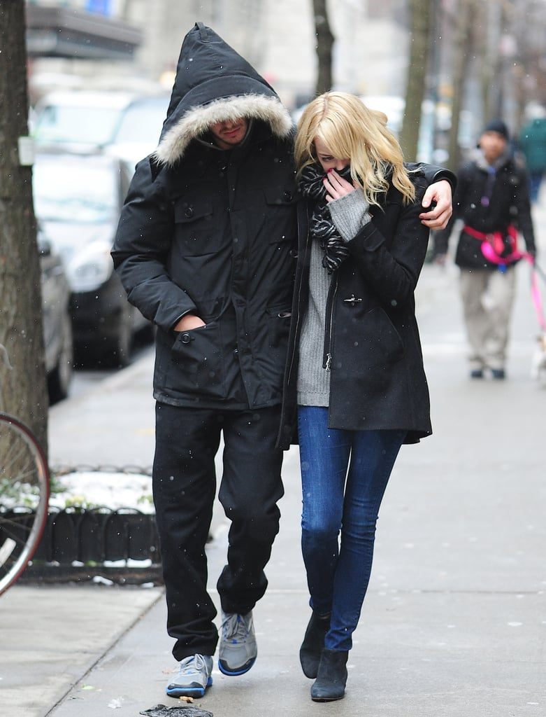 Cute couple Andrew Garfield and Emma Stone kept each other warm as they strolled the streets of freezing New York on February 5.