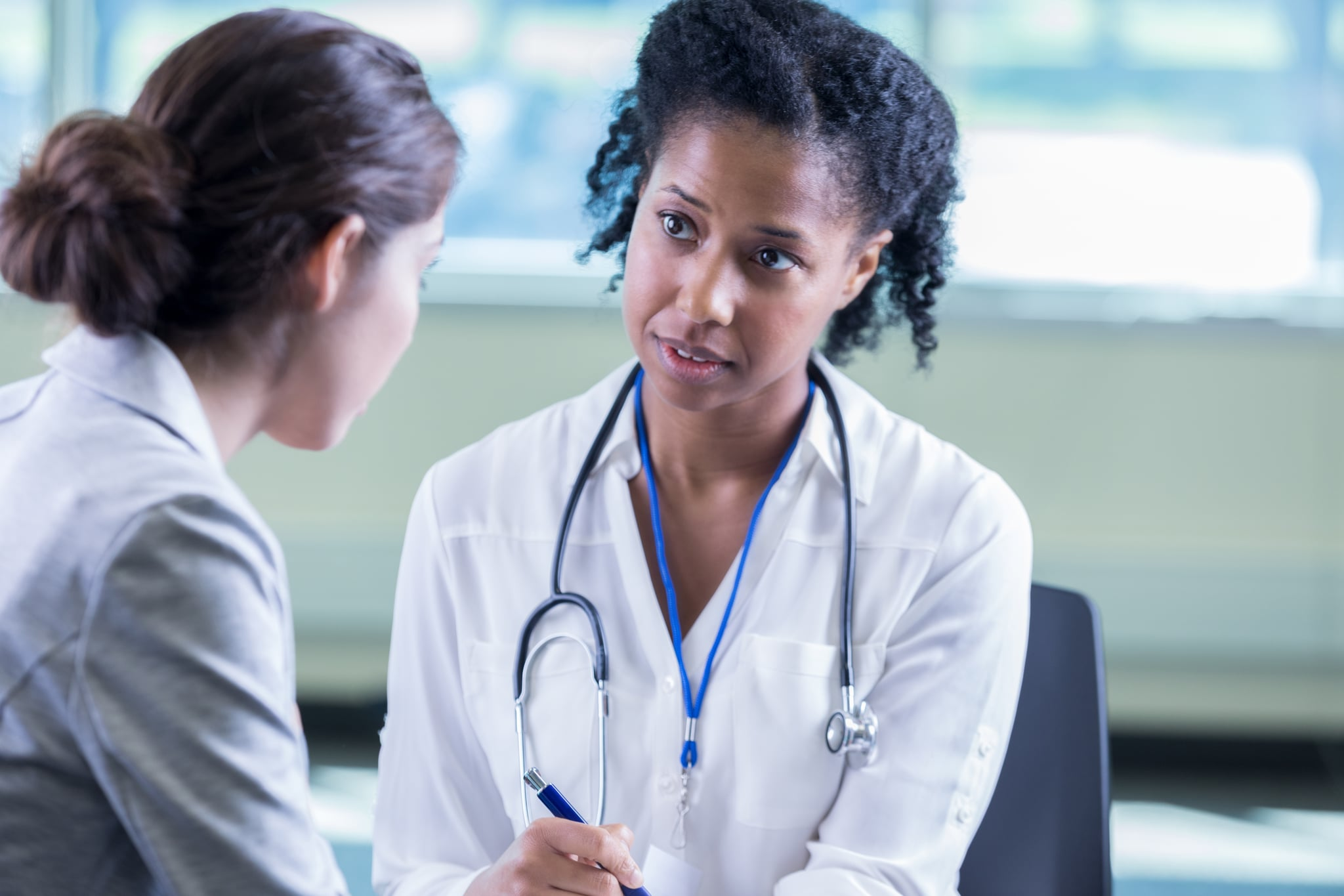 A compassionate female doctor with female patient