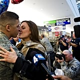 A couple shared a not-so-private kiss upon the return home of the 300 Airmen, the last Air Force personnel from Iraq, at Baltimore Washington International Airport in Baltimore on Dec. 20, 2011.