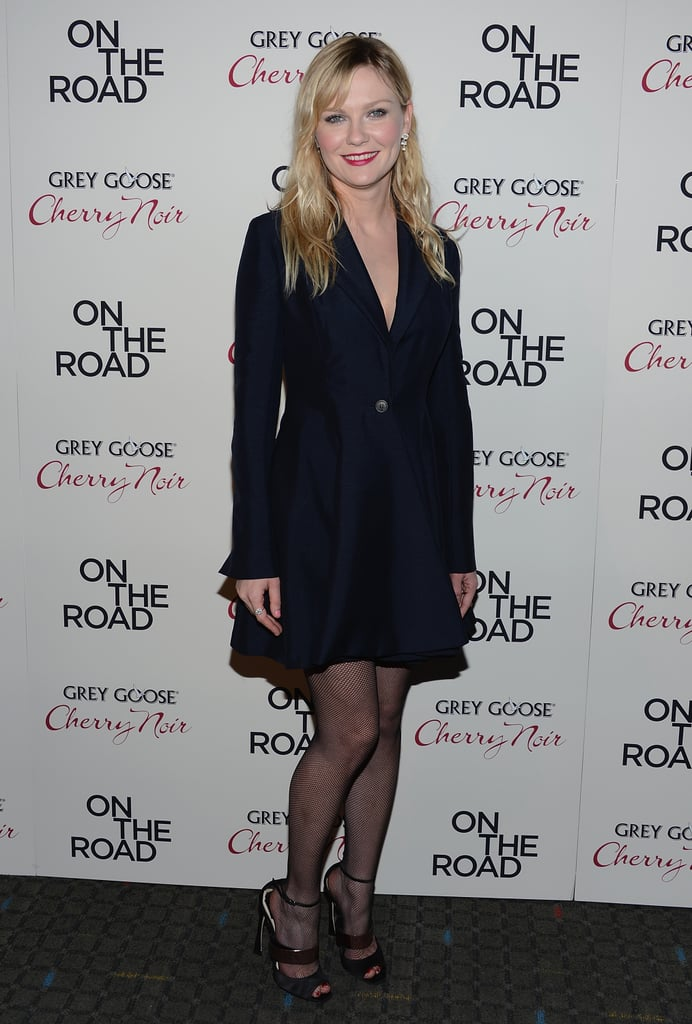 Kirsten Dunst sported a navy Christian Dior coat dress from the Spring 2013 collection for the On the Road premiere in NYC.
