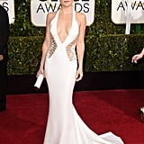 Kate Hudson was a candidate for the sexiest look on the red carpet in this white-hot Versace gown in 2015.