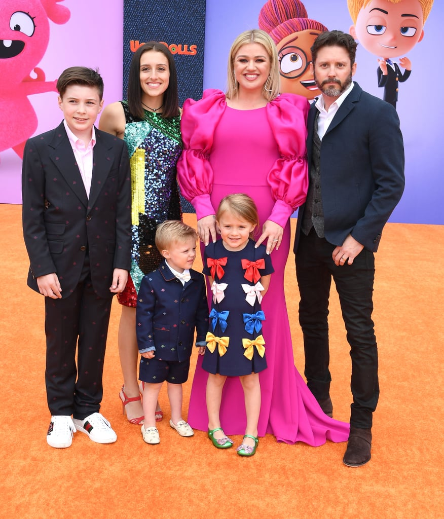 "On April 27, stars of the upcoming film UglyDolls descended on the red (or orange, I suppose) carpet for the movie's Los Angeles premiere. Kelly Clarkson — who lends her voice to the main character and the film's soundtrack — was in attendance with husband Brandon Blackstock and their four children: Savannah, 17, Seth, 12, River, 4, and Remington, 3. The actress wore a gorgeous hot pink voluminous gown as an ode to her lovable character, Moxy.  Her costar Blake Shelton also attended the event with girlfriend Gwen Stefani. They were joined by Gwen's sons Kingston, 12, Zuma, 10 and Apollo, 5, whom she shares with ex-husband Gavin Rossdale. Both of the families posed for a few adorable snapshots (which we're hoping will be framed and hung somewhere in their homes). Thanks to the movie's all-star cast, a handful of other big-name celebrities — including Janelle Monáe, Nick Jonas, Pitbull, and Emma Roberts — made their way to the colorful get-together and posed with life-size characters from the movie. Ahead, view all the fun photos from the big premiere!      Related:                                                                                                                                Kelly Clarkson's ""Broken & Beautiful"" Music Video Features the Cutest Cameo From Her Daughter"