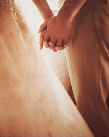 Blake Lively and Ryan Reynolds held hands on their wedding day.