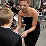 Scarlett made a little boy's day by signing an autograph at The Avengers premiere in Hollywood in April 2012.