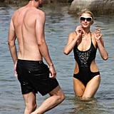 Paris Hilton and her new man cooled off in the water on an Italian island.