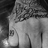 """In honor of his 16th wedding anniversary to Victoria, David got a small """"99"""" tattoo on his pinkie finger to commemorate the special occasion."""