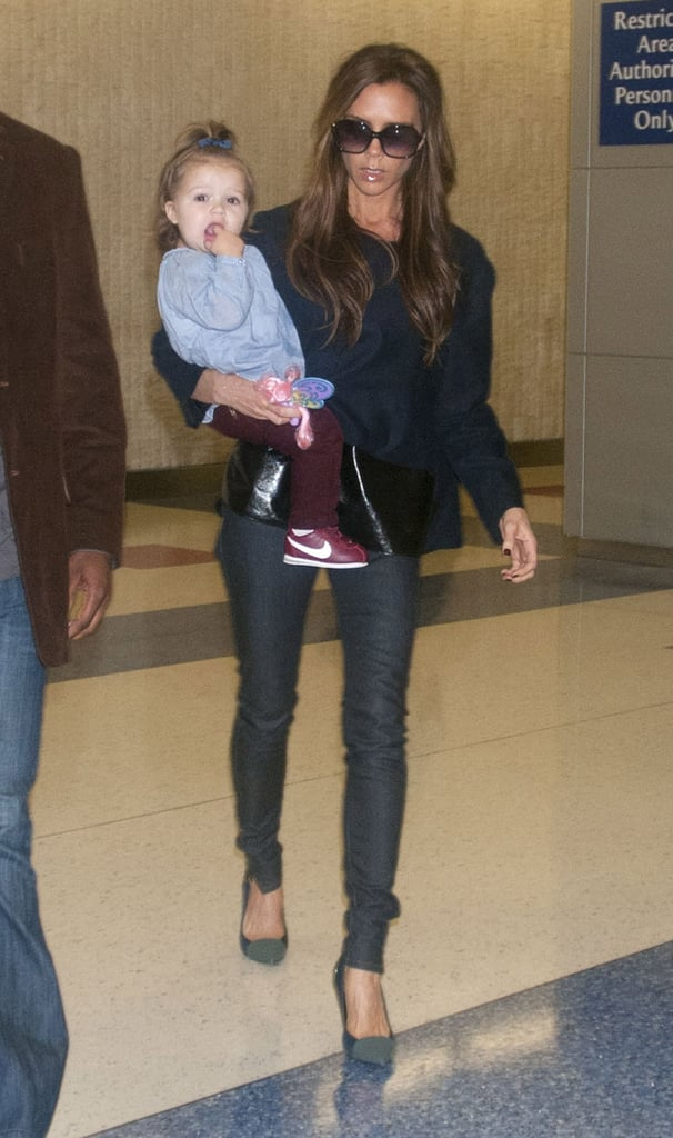 Victoria Beckham and her daughter Harper Beckham arrived at JFK Airport in NYC on Friday night. Posh was decked out in her usual high heels, while Harper was adorable in toddler-sized Nikes. The Beckham ladies were fresh off a flight from London, where they spent much of the last week. Victoria shopped around London, popping in to buy vintage clothing, but she also made sure to log time at work. While Victoria was abroad, her husband David Beckham was at home in LA with their three sons. David took his motorcycle out for a spin when he wasn't busy with the boys or practicing with the LA Galaxy. Today, though, he's on the road with the team since he and his squad have an away game in San Jose, CA.