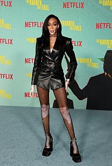 Winnie Harlow Wears a Black Leather Versace Blazer Dress