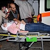 After shelling in the government-held side of Aleppo, an injured woman is rushed to the hospital.