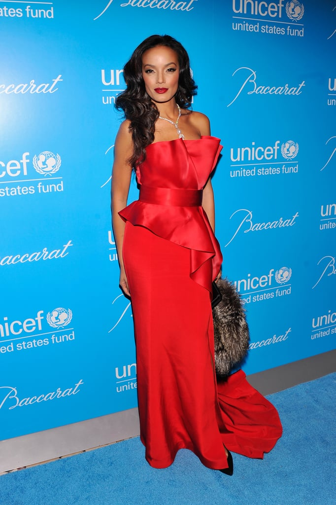 Selita Ebanks stunned in a sculptural red strapless gown.