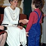 Diana shook hands with a young boy attending the Zakladni School For The Deaf and Hard of Hearing during her tour of Czechoslovakia in May 1991.