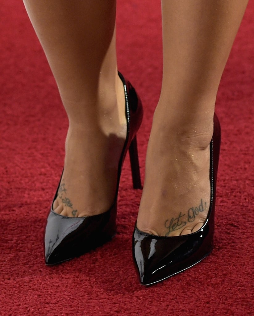 "Demi's foot tattoos read: ""Let Go & Let God."" Rumor has it this is her favorite ink."