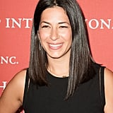 Straight hair with a middle part and a subtle makeup palette is becoming a signature for designer Rebecca Minkoff.