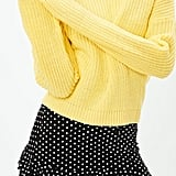 Add a yellow sweater ($18).