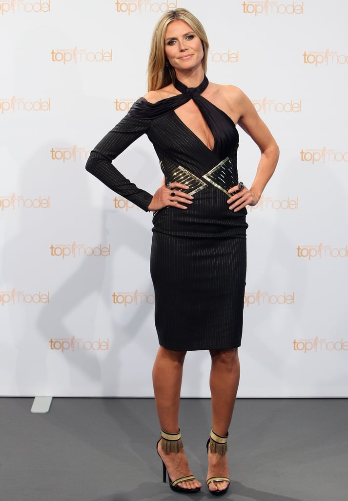 Heidi Klum put her shoulder on display in an asymmetrical black pin-striped dress and fringe sandals at a photocall for Germany's Next Topmodel in Berlin.