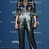 Amber Valletta joined Gucci at the Art + Film Gala in a high shine pants design.