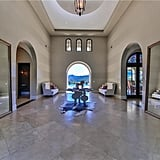 Arched doorways give the mansion that Mediterranean feel.