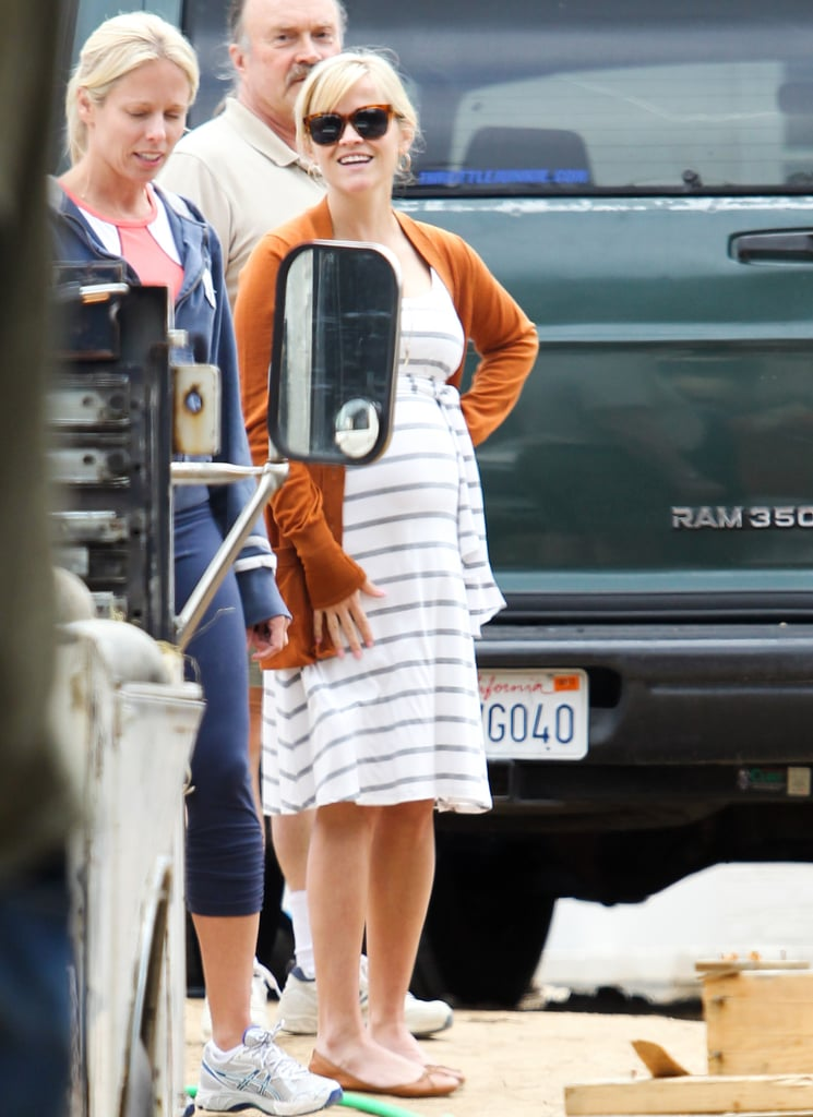 Reese Witherspoon stopped by a construction site in Brentwood yesterday in a white striped dress and ballet flats. She chatted with the crew and was all smiles before heading on her way. Reese and husband Jim Toth were spotted checking out Brad Pitt's Malibu property last Summer, but in the end Ellen DeGeneres ended up making a bid on the $12 million oceanfront mansion. Reese's family is expanding and with her third child on the way she could be looking for room to grow.  So far pregnancy hasn't impacted Reese's busy travel schedule. Reese joined an A-list crowd in Washington DC over the weekend at the White House Correspondents' Dinner and she recently returned from a family trip to Costa Rica with Jim, Deacon, and Ava.