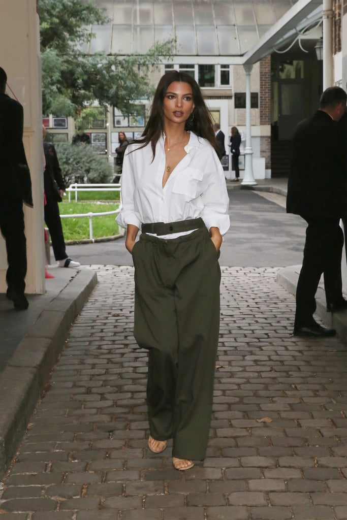 Emily Ratajkowski Attending the Valentino Show Wearing Green Trousers and a White Button-Down