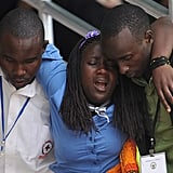 A young woman was helped out of Amahoro Stadium after being overcome with emotion. NPR reported that mourners like her were taken to a special room stocked with mattresses where they could rest.