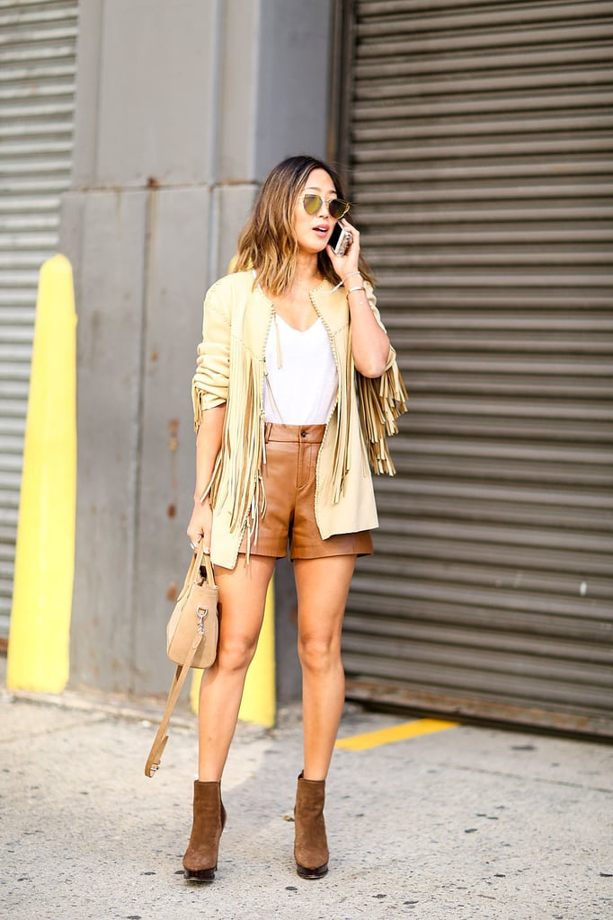 Go for a fully neutral ensemble that includes a fringed piece and let your shorts blend right in.