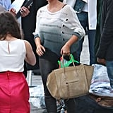Kim Kardashian carried an oversized bag on the set of the photo shoot.