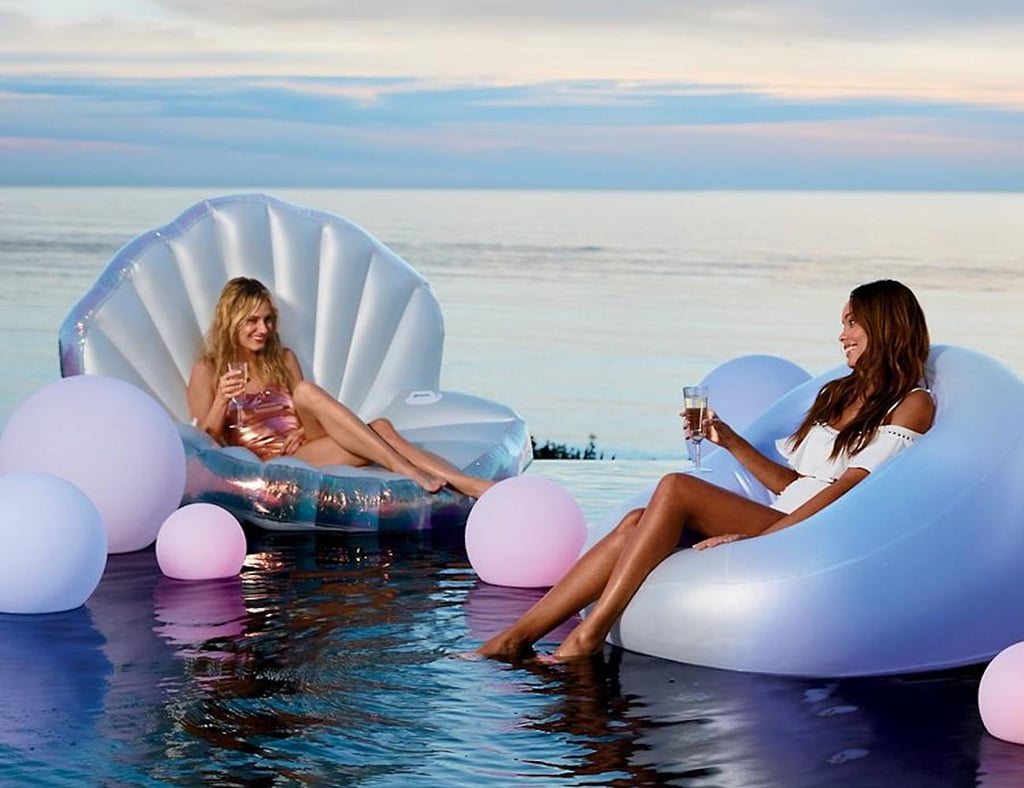 Flat pool floats are great and all, but have you ever seen one that's essentially the aquatic equivalent of those neon blow-up chairs you loved so much in the '90s? (Yes, the one with the squeaky plastic.) Well, it exists. Home decor retailer Frontgate currently offers a color-changing Glow Float ($129) that's perfect when you want to lounge in the pool but not, like, in the pool. The rather bulbous float is easily inflatable with an air pump and accompanying remote control. The best part, however, is the button on the back that allows you to change the color of the float between 12 different options. See more pictures and shop the pool-party-starter ahead.      Related:                                                                                                           Wannabe Mermaids, Add This HUGE Seashell Pool Float to Your List of Summer Necessities