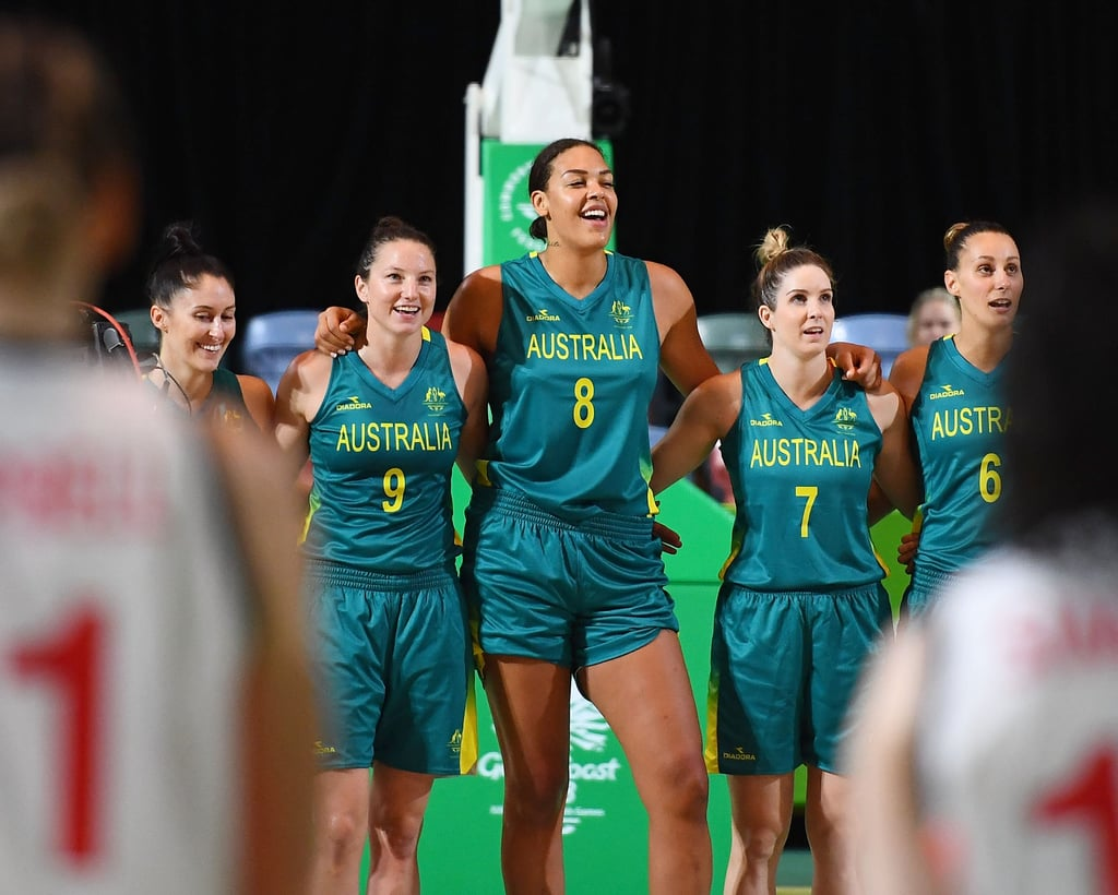 Our women's basketball team proudly sing the national ...