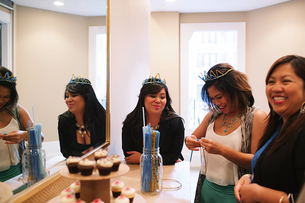 Guests made sparkly crowns out of blue and gold pipe cleaners. Photo by Ettevy Photography