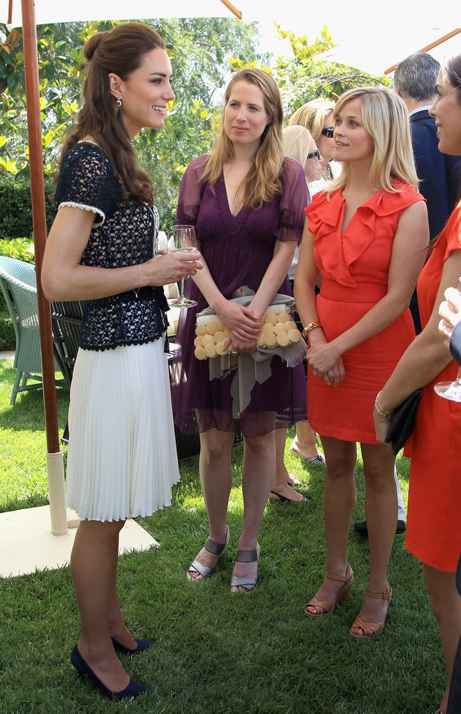 The Duke and Duchess of Cambridge spent their morning at a private reception at the home of producer Steve Tisch in Beverly Hills today. Kate wore a blue top and white skirt from UK brand Whistles. The event marked the launch of Tusk's US Patron's Circle and celebrity guests Catherine Keener and Linda Evangelista were on hand to show support. Kate Middleton and Reese Witherspoon talked during the bash as well! Reese expressed her excitement for the royal wedding earlier this year, just after her own nuptials to Jim Toth in April. Prince William and Kate Middleton have been mingling with many famous faces since their arrival in LA on Friday. Last night they attended the BAFTA Brits to Watch dinner and during the evening were spotted chatting with Jennifer Lopez, Jennifer Garner, Barbra Streisand, Tom Hanks, and others. William and Kate will next make a visit to Inner City Arts before finishing their California tour at the Service Nation: Mission Serve Event.