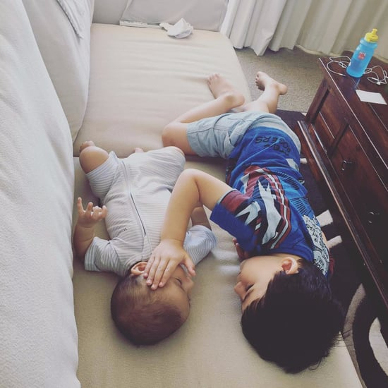 Toddler Comforting Baby Brother With Cancer