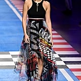 Wearing a racer-inspired dress during the Tommy Hilfiger x Gigi Hadid show in Milan.