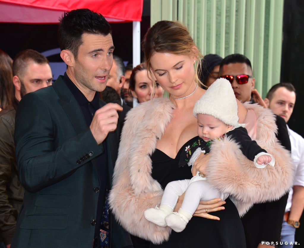 Adam Levine was honored with a star on the Hollywood Walk of Fame on Friday, and had the support of not only his fellow The Voice coaches Blake Shelton and Gwen Stefani, but also his adoring wife, Behati Prinsloo, and their 4-month-old daughter, Dusty Rose. Behati held on to the little one in her seat next to Gwen while Adam was presented with his plaque, then the trio posed for a few sweet family photos together in front of Adam's star. We last caught a glimpse of Adam and Behati when they stepped out for an adults-only date night at an LA Lakers game in November; that same month, Adam made an appearance on The Ellen DeGeneres Show and revealed that the host was the one who gave them the baby girl's name.      Related:                                                                The Caption on Adam Levine's Sweet Family Photo Will Melt Your Cold, Black Heart                                                                   Adam Levine and Behati Prinsloo's Romance Is as Perfect as a Sunday Morning