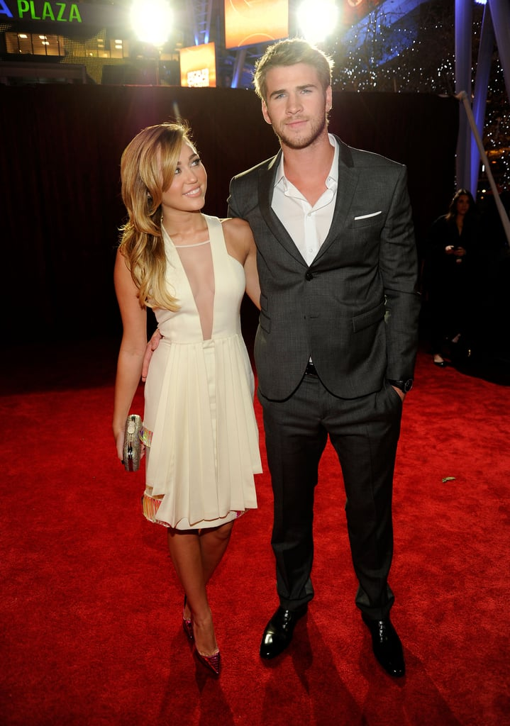 Miley Cyrus and Liam Hemsworth stepped out arm in arm on the red carpet at tonight's People's Choice Awards in LA. The singer wore a knee grazing halter dress while Liam opted for a sexy suit. The pair recently returned from their loved-up trip to Hawaii where Miley slipped into a sexy red bikini. It was a big day for The Hunger Games star Liam, who joined Jennifer Lawrence and Elizabeth Banks at a press junket for the film. We had the opportunity to sit down with the Liam and the cast to chat about the movie — stay tuned for our The Hunger Games PopSugar Specials soon!   Liam's not the only one with a hot new film heading to theaters. Miley shares the big screen with lovely ladies Demi Moore and Ashley Greene in their upcoming release, LOL. The night is just beginning so make sure to check back for all the latest from the event and weigh in on all of Fab and Bella's