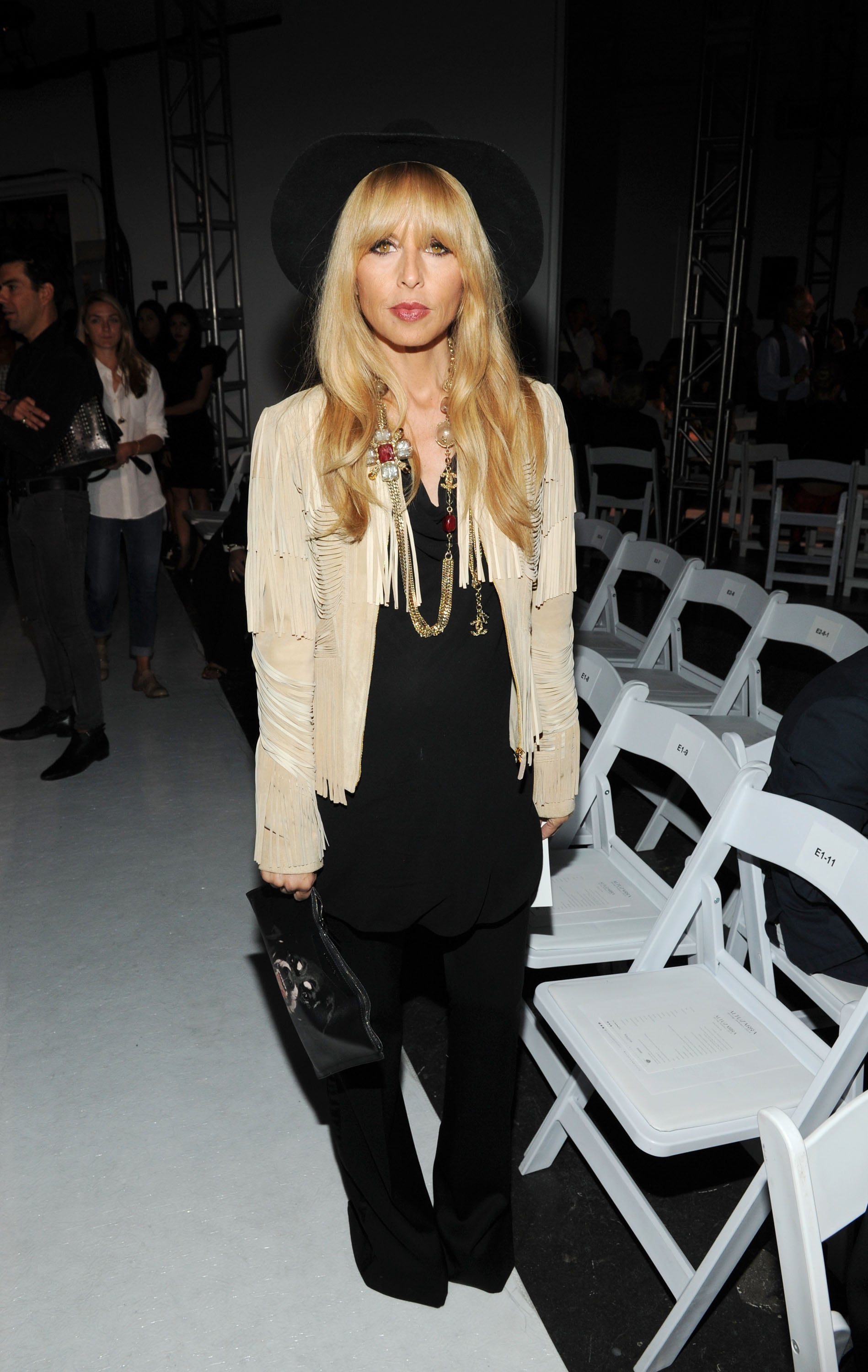 Rachel Zoe was in the bohemian spirit at Altuzarra. She matched a black jumpsuit with a black wide-brim hat, then threw on a suede fringe jacket and a Chanel necklace to finish.