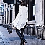 An Open-Back Sweater With Chain-Detail Boots