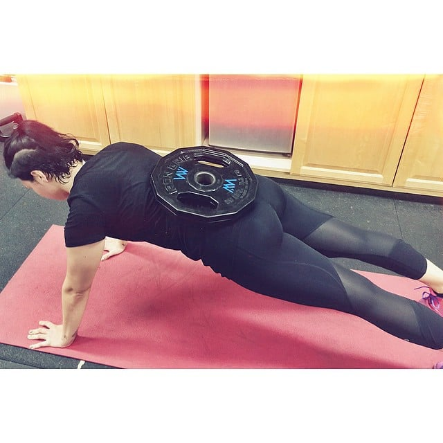 Demi Lovato's workout involved 25-pound push-up hold planks. Now that's one way to get strong!