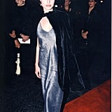 Then: No one can forget Angelina's goth-inspired looks from the '90s. Of course, she usually brought them lots of edge, showing off her hip bones in low-waisted jeans or, in this case, throwing on a dramatic velvet cape.