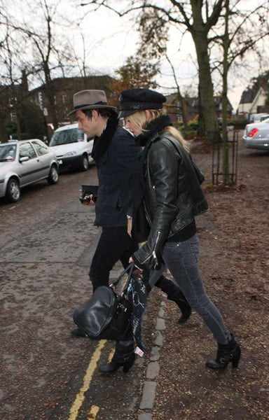 """Lopsided"" English Girl Kate Moss Has a Rainy Day With Husband Jamie Hince"