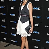 Toughening up a pretty dress with a menswear-style vest at a Longchamp party in 2008.