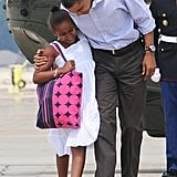 Barack boarded Air Force One with Sasha before flying to Martha's Vineyard in August 2009.