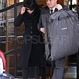 Hilaria Thomas had some help carrying a Dolce & Gabbana garment bag in NYC.