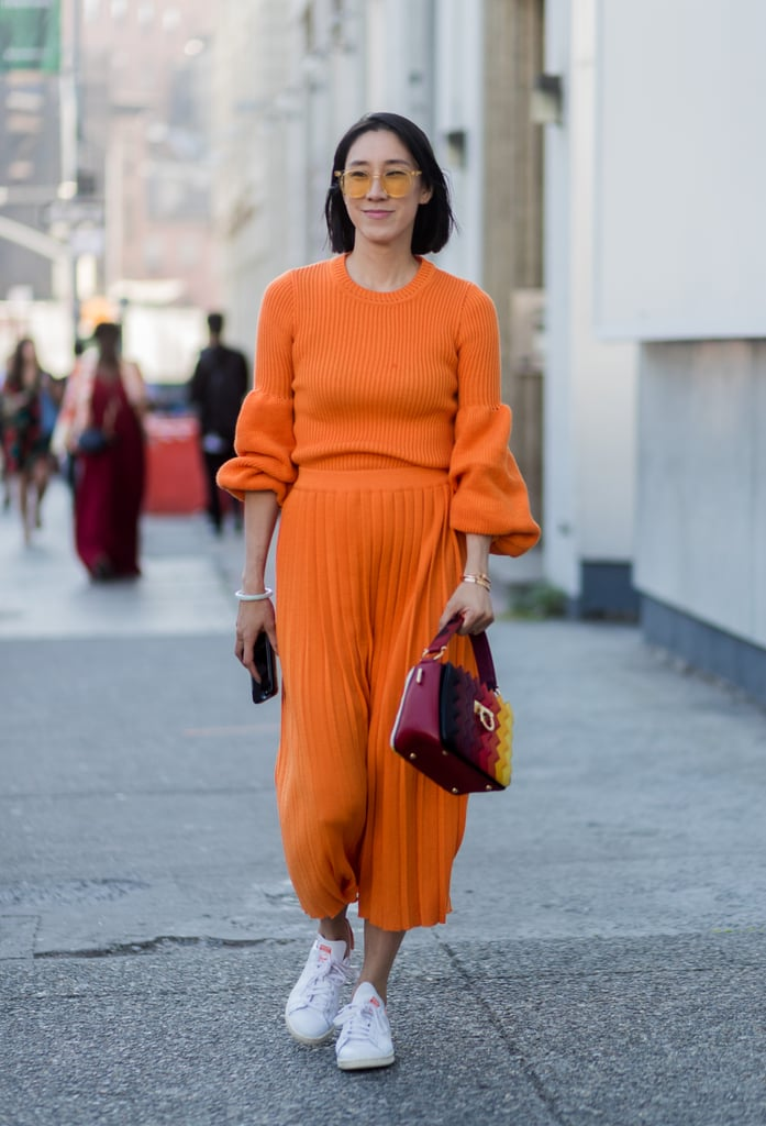 Eva Chen went for it at New York Fashion Week by wearing head-to-toe orange. Going monochrome is one of the easiest ways to rock the trend without worrying about what matches what.