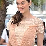 Marion Cotillard posed at the photocall for Rust and Bone at the Cannes Film Festival.