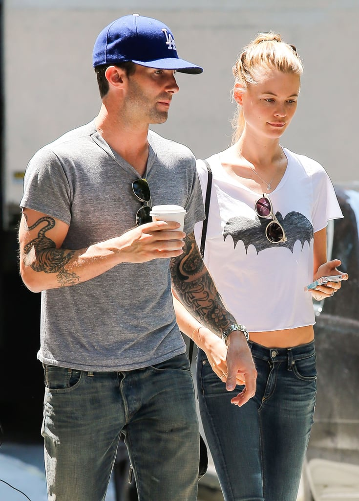 Adam Levine wore an LA Dodgers hat while walking with Behati Prinsloo. 719e3cc43b6