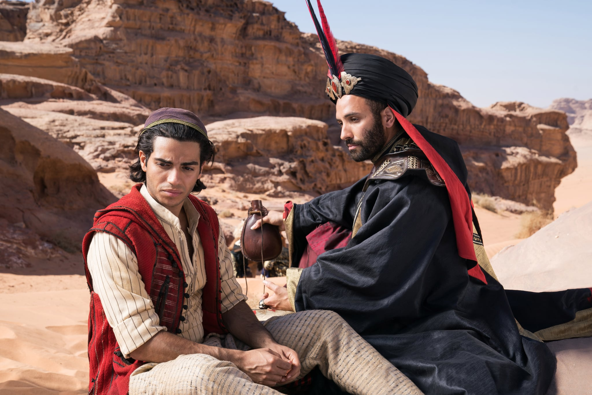 Mena Massoud is Aladdin and Marwan Kenzari is Jafar in Disney's live-action ALADDIN, directed by Guy Ritchie.
